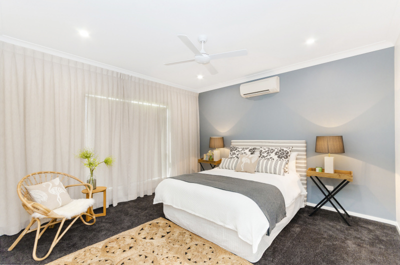 Main bedroom image, queen size bad and seating area
